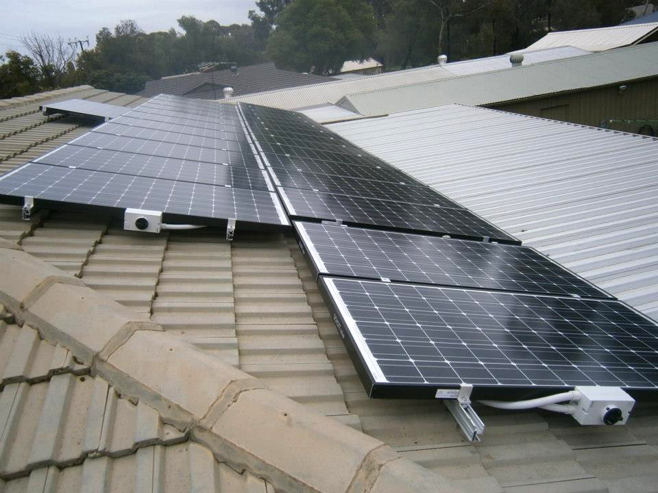 Large PV panel array on tiled Suburban roof