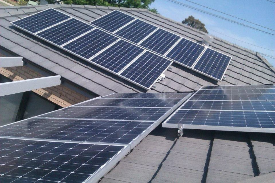 Solar panels across two tiled Suburban roofs