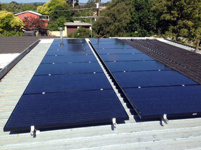 Roof mounted Solar Panels alongside Solar Pool heater